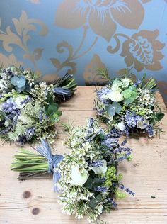 A gorgeous Spring bouquet of lavender, bluebells, white roses, wax flower, alchemilla mollis, brunia, and eucalyptus to create bouquets of soft whites, creams and steely blues and greys