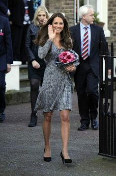 Kate - Love this pic. She looks so happy AND pretty.