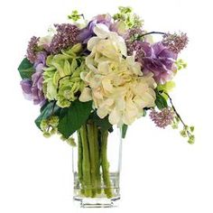 "Featuring faux hydrangeas and lavender in a classic glass vase, this charming arrangement offers garden-inspired style for your entryway or living room.    Product: Faux floral arrangementConstruction Material: Silk, plastic, acrylic and glass Color: Purple, green and white Features:  Includes faux hydrangeas and lavender Dimensions: 16"" H x 10"" Diameter"