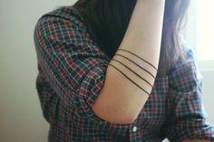 I kind of like the idea of just getting a few simple lines, like bracelets.