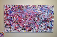 Splatter a canvas sheet with brushes, balloons of paint, syringes of paint, roll balls on it with paint on them...