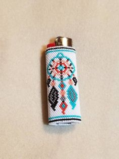 native american beadwork patters This lighter cover has a dreamcatcher on both sides. This beaded cover fits a standard size lighter. Lighter not included. The patter Native Beading Patterns, Bead Embroidery Patterns, Beaded Earrings Patterns, Native Beadwork, Seed Bead Patterns, Native American Beadwork, Beaded Embroidery, Bracelet Patterns, Art Patterns