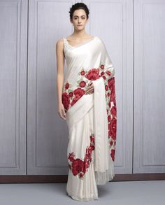 Buy Ivory Satin Sequined Saree By Manish Malhotra online in India at best price. vory satin saree with green and red resham and sequins jaaland flower embroidery, teamed with ivory Simple Sarees, Trendy Sarees, Stylish Sarees, Fancy Sarees, Party Wear Sarees, Saree Blouse Patterns, Saree Blouse Designs, Indian Dresses, Indian Outfits