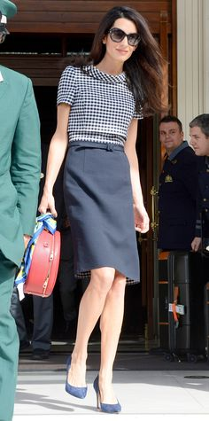 Even if you are on top of every trend, it's best not to experiment with every one in the workplace. When gingham print first reigned supreme, Clooney tried out the trend by wearing the pattern in safe neutrals and classic silhouettes.