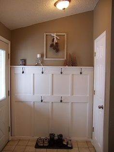 board and batten with hooks for new mudroom.