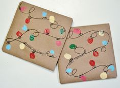 Create some cute holiday lights on your wrapping paper! This one is super easy as you just need some finger paint and a sharpie.