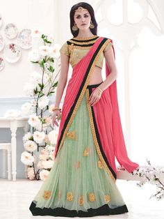 Sensuous aqua and pink color net and #lycra #saree with #zari, sequins, kundan work. Item Code: SAV3923 http://www.bharatplaza.com/new-arrivals/sarees.html