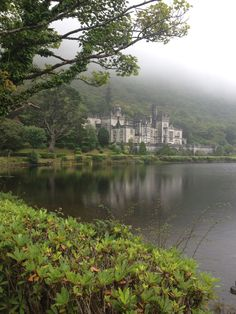 Kylemore Abbey & Victorian Walled Garden, Galway, Ireland — by Shelby Phillips. The fog covered the hills. It was so beautifully eerie.