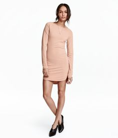 Check this out! Short dress in crêped stretch jersey with extra-long raglan sleeves, opening at back, and rounded hem with short slits at sides. Slightly longer at back. - Visit hm.com to see more.