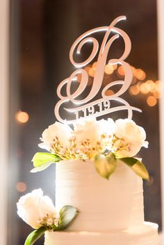 This wedding cake had a beautiful cake topper! The white flowers and subtle greenery on this cake were stunning! This wedding took place at Ashton Gardens in Sugar Hill, Georgia! Ashton Gardens, Sugar Hill, Unique Wedding Venues, Chapel Wedding, Beautiful Cakes, White Flowers, Cake Toppers, Greenery, Tea Pots