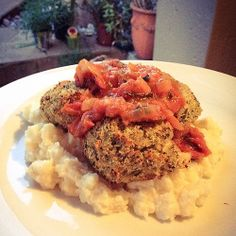 Hake and kingklip #paleo fish cakes over Creamy celeriac mash topped with fresh tomato relish.