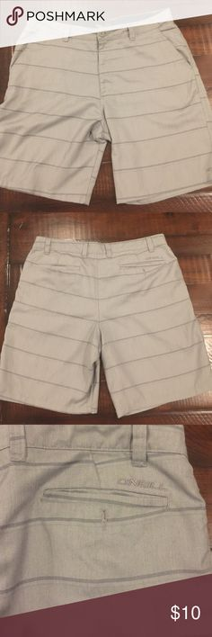 Men's ONeil swim and wear board shorts Excellent condition men's ONeil's swim and wear board shorts. Can dress up or dress down! Grey striped like new size 38 men's shorts O'Neill Shorts