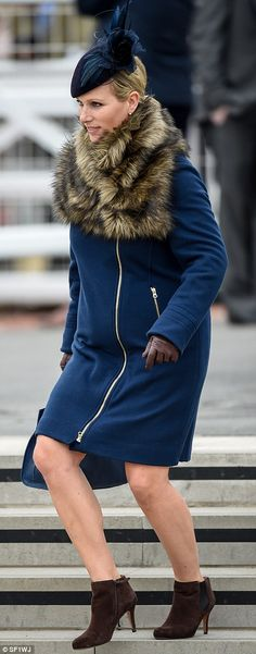 Looking good: Zara cut an elegant figure in her blue coat, brown boots and matching velvet...