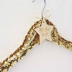 Leave a little sparkle wherever you go.Available in silver and gold.This beautiful, luxurious sequined hanger is personalised with a little star and engraved with your choice of words. Treat yourself or buy for a friend to ensure her big day is even more special. Do you love the feeling of receiving something special? We do. That's why we create gifts you love to give, moments you love to share. Create your gift. Share your moment.Wooden hanger, silver or gold sequins, wooden star43cm