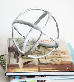 Create this West Elm inspired decorative sphere, but for WAY cheaper! All you need is some embroidery hoops, clay, and paint! blitsy.com