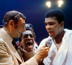 Howard Cosell interviews Muhammad Ali, with entertainer Sammy Davis Jr., after Ali's victory over Joe Bugner by a 12 round unanimous decision at the Las Vegas Convention Center in 1973.  (Neil Leifer/SI) GALLERY: Neil Leifer's Iconic Boxing Photos