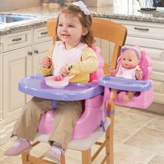 this would be fun to have. booster seat with a spot for baby doll