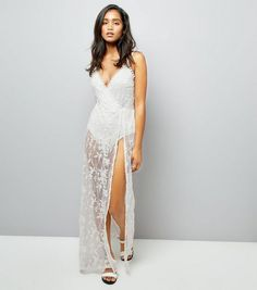 http://www.newlook.com/row/womens/clothing/dresses/parisian-white-floral-mesh-maxi-dress/p/538304210?comp=Browse