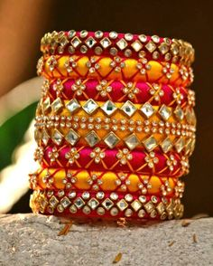 Check out these silk thread bangles design like multicolored bangles, handmade bangles, kundan bangles, etc and find the most stylish silk thread bangles for bride. Silk Thread Bangles Design, Silk Thread Necklace, Beaded Necklace Patterns, Thread Jewellery, Fabric Jewelry, Jewelry Patterns, Jewellery Designs, Mehndi Designs, Kundan Bangles