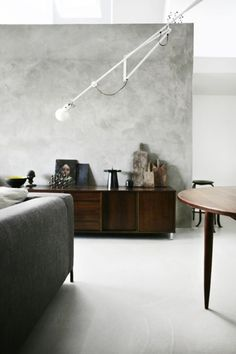 Love the mix of concrete and old dark wood