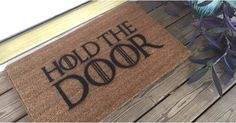 Hold the Door! Show your love for Hodor with this custom Game Of Thrones doormat. An awesome addition to your home or a great gift for any Game of Thrones fan. This 18 x 30 coir door mat is custom designed and hand painted. Ships from Atlanta, Georgia. Game Of Thrones Decor, Game Of Thrones Gifts, Game Of Thrones Party, Game Of Thrones Quotes, Game Of Thrones Funny, Game Thrones, Game Of Thrones Halloween, Game Of Thrones Costumes, Game Of Thrones Christmas