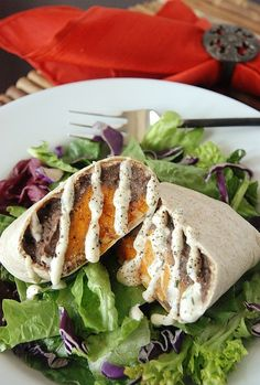 Sweet Potato Black Bean Burritos with Chipotle Crème Fraiche! They are vegetarian & packed full of vitamins & nutrients. And the best part is that they freeze incredibly well!