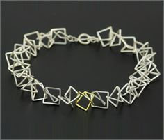 Dancing_squares_necklace_in_silver_and_gold_G.jpg 291×249 pixels
