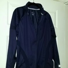 Nike Dri-Fit Running/Workout/Athleisure jacket Lightweight but WINTERIZED running jacket. Never worn/NWOT. Wicking material, but great for athletic or athleisure. Eggplant purple in color with thumb holes. Nike Jackets & Coats