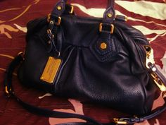 Kinks are the new pink purse contents--  lovely navy marc jacobs purse