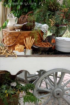 old wagon cart used as an appetizer and serving station for a fall meal.