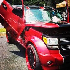 My #ride at one of the #carshows  #dodge #dodgenitro #nitro_riot  #lambo #lambodoors #verticaldoors #custom #lamborghini #24s #lowprofile #carbonfiber #lesonal #nitro #florida #orlando #tampa #toy #dailydriver #5starcars #Padgram