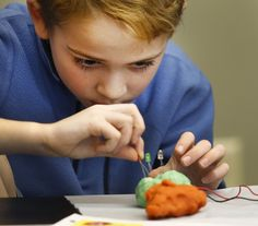 Finn Sheffield, 8 works on making a complete circuit.   Fun making circuits with Krissy Cannizzo of the Children's Museum in Easton during a clinic at the Pratt Library in Cohasset on Wednesday Feb.15, 2017  Greg Derr/The Patriot Ledger