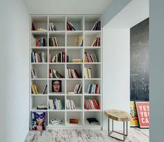 Apartment White Varnished Wooden Floor To Ceiling Bookshelf White Wall Unrefined Looking Floor Reclaimed Wood Piece Stool Industrial Apartment Industrial And Scruffy Stylish Bachelor's Apartment