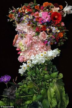 A stunning image of a gentleman made entirely out of actual flowers and leaves originally painted by Arcimboldo