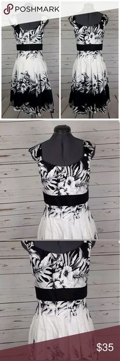"""WHBM Black & White Floral Dress Size 4 Gently used with no flaws, see photos  Material:Cotton, Spandex  Measurements: 17"""" armpit to armpit 15"""" waist while laying flat 38"""" in length  Please feel free to contact us with any questions or if additional picturesor measurements are needed, we'd be happy to help.  Thank you   A01 White House Black Market Dresses Midi"""
