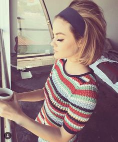 Lucy Hale: Feeling retro? Try this super groovy ensemble. Use a bold headband to push back your backcombed hair into a slick bouffant, and pair with an equally trendy knit top. (Photo via /lucyhale/)
