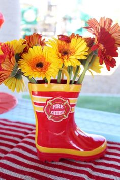 Red and yellow flowers from Vintage Fireman Themed Birthday Party at Kara's Party Ideas. See more at karaspartyideas.com!
