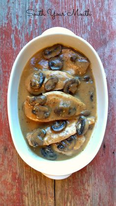 Crock Pot Smothered Chicken with Mushroom Gravy! Chicken and mushrooms in an easy scratch-made gravy  (no canned soups!) slow-cooked in the crock pot or right on the stove.