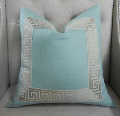 aqua linen pillow with attached greek key trim