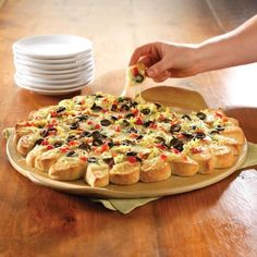 Cover cheese and veggies on bread bake in the oven and you have a great Super Bowl appetizer