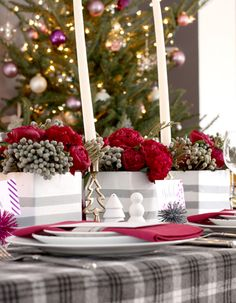 """What I really like about this table is how they don't use anything traditional except the use of red. The checkered tablecloth with the striped containers is so modern. Even the choice of flowers isn't """"Christmas-y"""". Christmas Colour Schemes, Christmas Colors, Christmas Time, Christmas Holidays, Christmas 2017, Christmas Ideas, Christmas Tablescapes, Christmas Centerpieces, Christmas Decorations"""