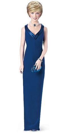 Princess Diana - Navy Blue Dress Porcelain Doll by Franklin Mint  A stunning resemblance in hand-painted porcelain. Dressed in a replica of one of her dazzling gowns—a sleek column of blue crepe. Accessorized with a faux-pearl necklace set with a faux sapphire, an elegant bracelet, faux-sapphire earrings and a clutch bag.