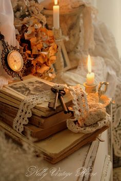 Romantic vintage accessorizing design details. Antique keys, lace, old books and soft candlelight.