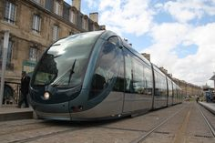 """Look Ma, no wires! Bordeaux needed a new transport system, but didn't want to clutter the beautiful city with wires or block pedestrians with barriers for a high-voltage third rail. Solution? Invent a flat, ground-level """"rail"""" that only activates while the train is above. 2003."""