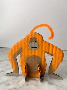 DIY Cardboard orangutan made from recycled boxes!  Easy to use templates!