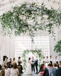 Southern Smilax ceremony installation by Roots Floral Design