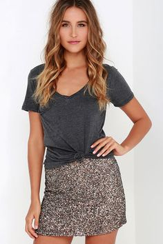 Get your glitz on with a little bit of help from the Billabong Showin' Off Bronze Sequin Skirt! Woven taupe fabric decorated with shimmering bronze and silver sequins shapes a chic, sheath skirt with a high, fitted waistline, and leg-baring length. Metal logo tag at back. Hidden zipper at side. Fully lined. Self: 100% Polyester. Lining: 100% Cotton. Dry Clean Only. Imported.