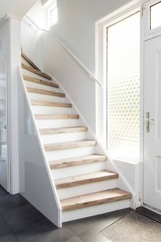 Many people consider the kitchen to be the heart of the home. Bringing this area of your home up-to-date to create a warm and inviting area for your entire Wood Stair Treads, Modern Stair Railing, Wood Staircase, Concrete Stairs, Stair Renovation, Small Space Interior Design, Stair Decor, House Stairs, Stairways
