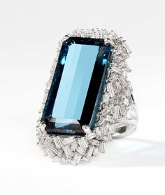 Suzanne Kalan one-of-kind white gold Vitrine ring with baguette diamonds and a 24.90ct London blue topaz ($18,000).