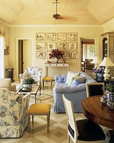blue and white print with dashes of yellow for accent, geometric-design on floor and those black dining chairs ~ Albert Hadley design 10.3.2014